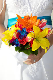 red roses orange lilies yellow lilies blue orchids pink tulips in bouquet