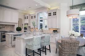 Luxury traditional kitchen with two islands, damasco white marble counters  and white cabinetry with glass