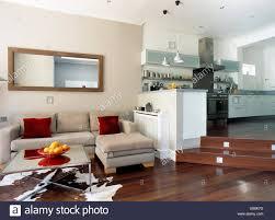 Split Level Living Room Rectangular Mirror Above Beige Suede Modular Sofa In Split Level