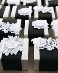 super cute favor boxes personalize them with names and dates Wedding Favor Ideas Black And White black and white favor boxes with marshmallows and local hot cocoa mix were wrapped in black grosgrain ribbon and topped with lace flower appliques wedding favor ideas black and white