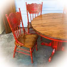 Red dining table set Paint Farmhouse Kitchen Table Set Vintage Pedestal Table Distressed Red Copper Undertones On Stained Solid Oak Four Matching Chairs Matching Table Leaf Pinterest Farmhouse Kitchen Table Set Vintage Pedestal Table Distressed