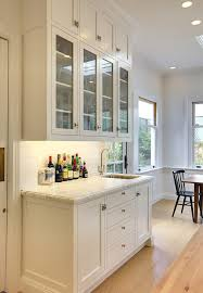 san francisco bar glass shelf with traditional faucets kitchen and white cabinets butcher block counter