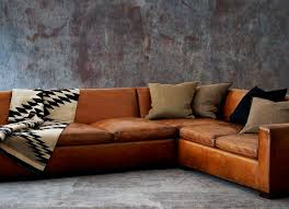 Modern leather couch Light Brown Leather Leather Sofa Styled With Brown And Black Pillows rl Home Leslies Furniture Leather Sofa Styled With Brown And Black Pillows rl Home Living