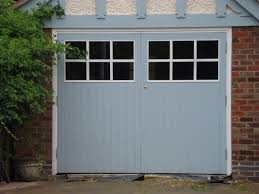garage doors with glass panels manufactured from cedar trustwood joinery manufacturers