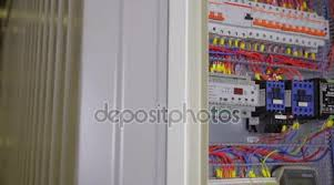 electric breaker box electrician testing and switching fuse electric breaker box electrician testing and switching fuse breaker in a fuse box stock footage
