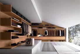 sweet closet designs in goldenrod color and wooden material with three hanging clothes areas shelves plus