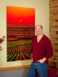 richard duval seattle area wine photographer in front of an image on metal