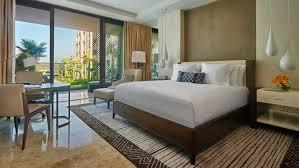 deluxe room hotel bed white teardrop hanging ls tables by patio doors