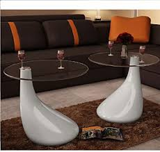 Glass, because of its transparent nature, allows the eye to travel through thereby giving the illusion of more space. Amazon Com Coffee Tables Set Of 2 Round Glass Top Center Table Sofa Side Table For Living Room White High Gloss 16 5 X 21 7 By Estahome Kitchen Dining