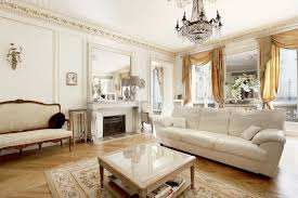 wondrous french interior design with beautiful chandelier over the white sofa and glass top wooden coffee