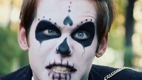 actor with zombie makeup on face having fun making scary grimaces into camera stock video