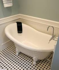 clawfoot tub on tile floor. claw foot tub, great wall color and tile. clawfoot tub on tile floor n