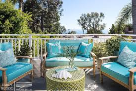 teak outdoor furniture with turquoise cushions