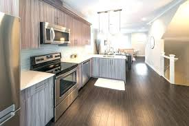 grey kitchens with white cabinets grey wood floor kitchen white wood surround fireplace mantel dark wood grey kitchens with white cabinets
