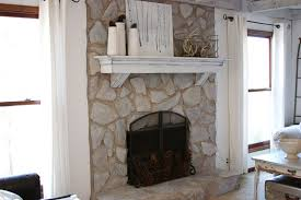 erin s art and gardens painted stone fireplace before and after this is what i m going to do to update that stone fireplace