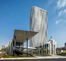 office facade. Kengo Kuma Creates A Pleated Aluminum Mesh Façade For Shanghai Office Tower Facade