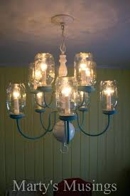 mason jar light fixtures have some extra mason jars and an outdated chandelier turn them into mason jar light