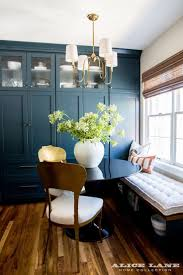 LOVE the color combination and feel of decor - Tiny but mighty dining room  nook with gorgeous Farrow + Ball paint cabinetry Alice Lane Home Collection