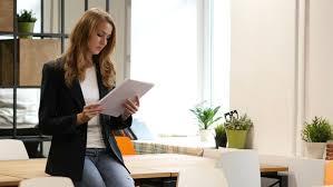 reading doents businesswoman sitting on desk paperwork 4k stock clip