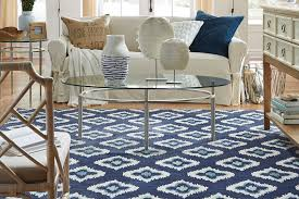 area rugs aren t exactly new to the world of interior design but they re more than just any old accent they can draw the eye warm a room