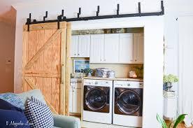 laundry room closet with diy sliding barn doors