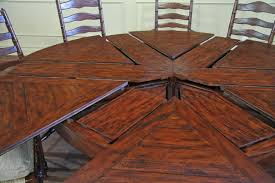 round expandable rustic dining table with leaves