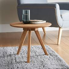 coffee table oak side table small round table in gray fur on the carpet and