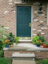 Go with a pop of color on your front door with turquoise, yellow, red, bright blue, or another color that will jump out. Vintage Sweet Peas Welcome Fall Green Front Doors Best Front Door Colors Front Door Colors