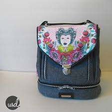 Blue Calla Patterns Gorgeous Clover Convertible Backpack Thumb Lock Train Case And Cross Body Bags