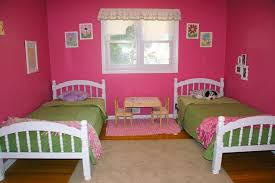 comely twin grils bedroom ideas presenting small study table and cute pink walls also white bed framw feat green bedding sets plus cream rug on brown