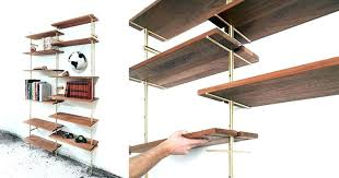 mid century floating shelves f9161 mid century modern floating shelves using brass and wood based designer has created this rail shelving mid century modern