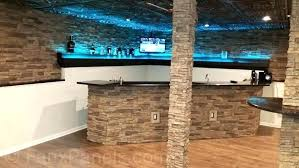 faux stone interior wall there is a wealth of in this basement home bar veneer panels