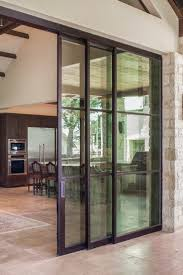 Large sliding steel doors obscure the boundary brining the outdoors inside  and allowing guests to flow freely from interior living space to .
