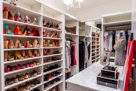 This white melamine walk-in closet keeps things simple yet beautiful with  multiple rows of shoe storage, with each one able to accommodate four pairs  of ...