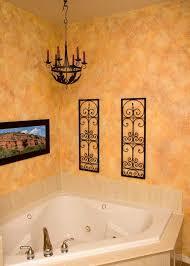 Sponge painting walls in guest bathroom