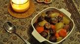 baked farmer sausage  potatoes  and carrots with gravy