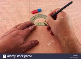 Graph Paper Draw On A Sheet Of Graph Paper Draw A Male Hand Drawing Stock Photo
