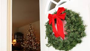 how to hang holiday decorations without