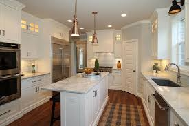 Narrow Kitchen Island With White Marble Counter And Cabinet