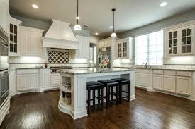 white kitchen cabinets with dark floors traditional kitchen with off white cabinets and dark maple floors