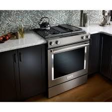 amusing kitchen backsplash with white granite kitchen countertops and black doors near downdraft electric range above