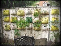 large size of backyard backyard vegetable garden recycled plastic planter bags hanging on the wire
