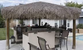 thatch roof square tiki bar in backyard