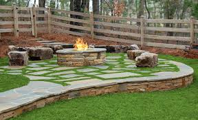 flagstone patio with fire pit. Enjoy The Fire On Fieldstone Boulders In This Mix Grey Flagstone Patio With Grass Growing Between Stones. Pit I