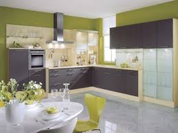 dark purple wooden kitchen cabinet and grey stainless hood connected from laminate flooring for green kitchen