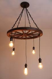 hanging lamp in industrial style it comprises 5 lights and is mounted on the chain