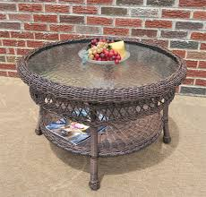 belaire round resin wicker cocktail or coffee table with glass top 19 5 high antique antique brown