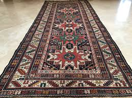 stunning antique persian tribal runner rug hand knotted wool rug measures 8 11 x