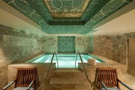 descend a grand spiral staircase to enter the st regis deer valley s remà  de spa in park city utah the outdoor hot tub is open year round and is built