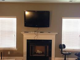 are you interested in mounting tv above fireplace. Hanging Tv Over Electric Fireplace Intended For Decoration Interesting Mounting A With Window Decor 7 Are You Interested In Above